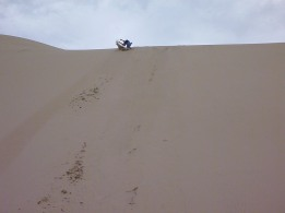 Chris doing flips down a sand dune