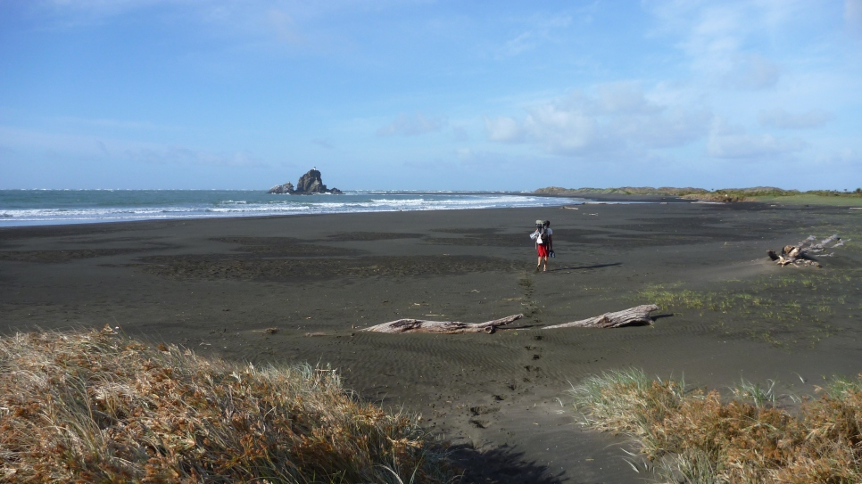 Hiking out along the black sand beach