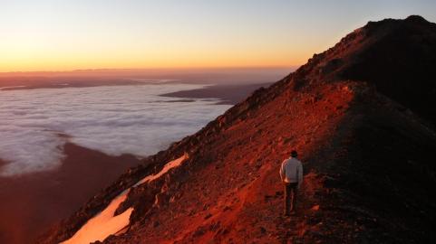 Chris on the summit of Mount Ngauruhoe at sunrise