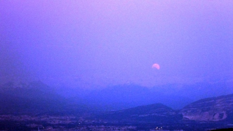 Moon rising behind the Alps