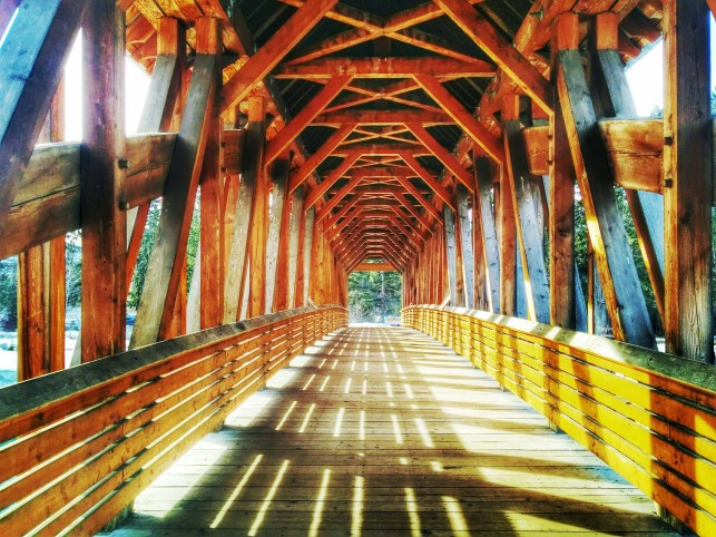Golden's famous pedestrian bridge: the longest freestanding timber frame bridge in Canada