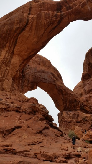 Chris stands near a double arch at Arches National Park