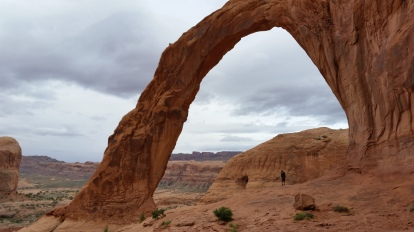Chris stands under Corona Arch
