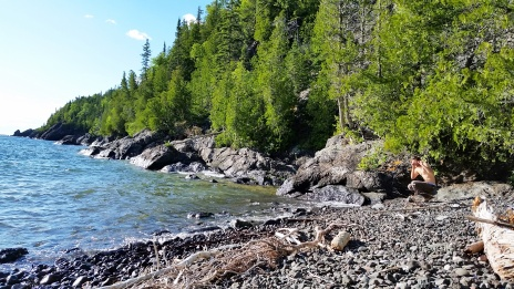 Chris investigating the rocky beach at our Devil's Chair campsite