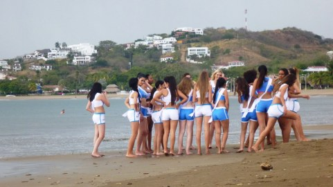 Miss Teen Universe contestants after they almost trampled us while running down the beach to get drown footage